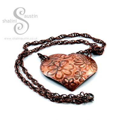 Gorgeous Puffed Copper Heart Pendant embossed with flowers.