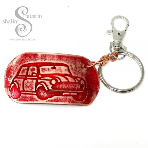 Embossed Copper Keyring MINI with a car pattern printed on the copper tag.