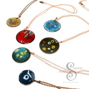 A selection of enamelled round copper pendants by Shalini Austin.