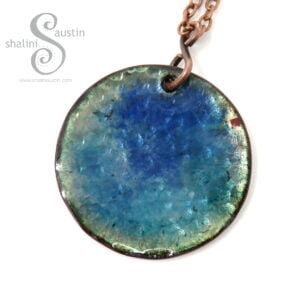 This Blue enamelled Copper Pendant OCEAN 01 is approximately 3 cm round.